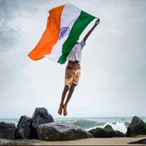 Happy Independence Day, Young boy jumping with Indian FLag