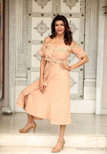 Lakshmi Manchus latest interview photos HD Quality (1080p) (lakshmi manchu, actress, model, kollywood, producer, television presenter, television actress, tollywood, deep neck dress, casual dress, high heels, interview, curly hair, frock)