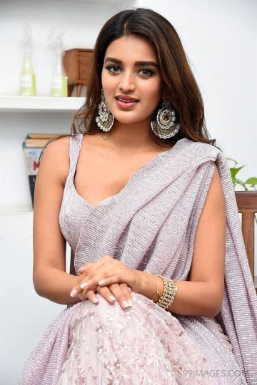 Nidhhi Agerwal Hot HD Photos in Violet Saree at iSmart Shankar Movie Interview