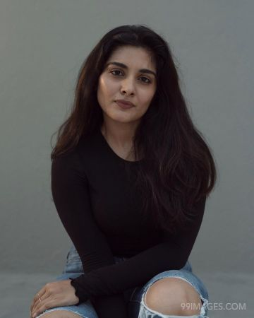 Nivetha Thomas Latest Hot Photoshoot in Black Dress HD Pictures