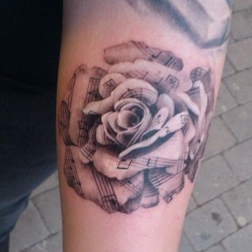 Black & White Rose Music Arm Tattoo Design
