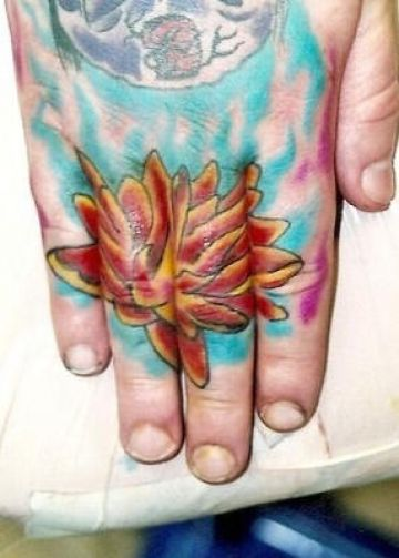 Red Lily Hand Tattoo Design