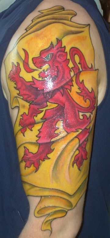 Yellow & Red Flag Lion Tattoo Design