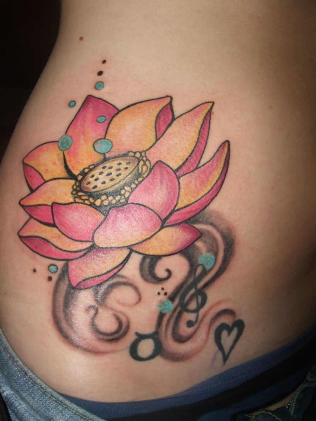Pink Lotus Flower Ribs Tattoo Design (286214) - Best  Tattoos