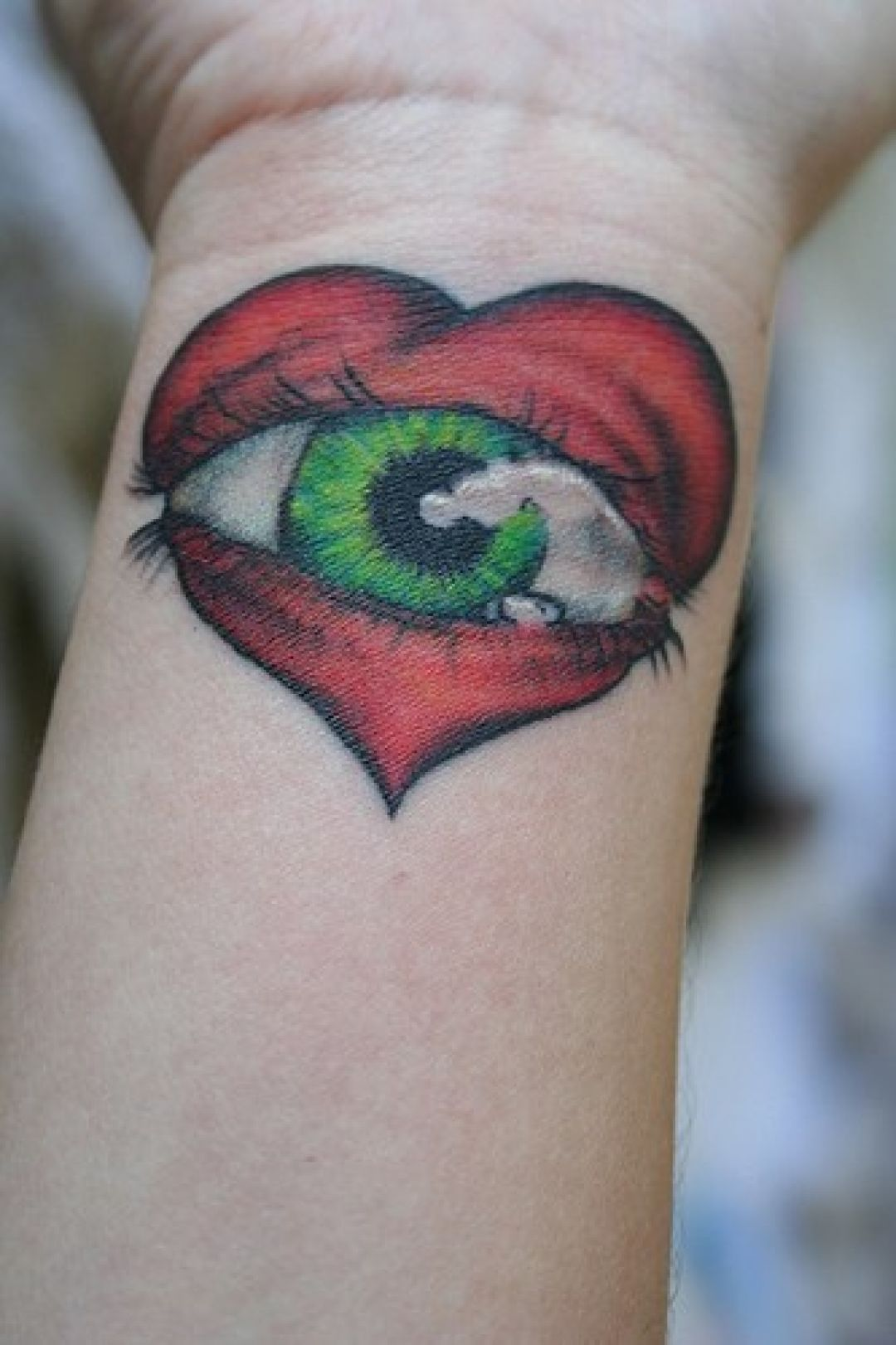 Red Heart Eye Wrist Tattoo Design (285225) - Best  Tattoos