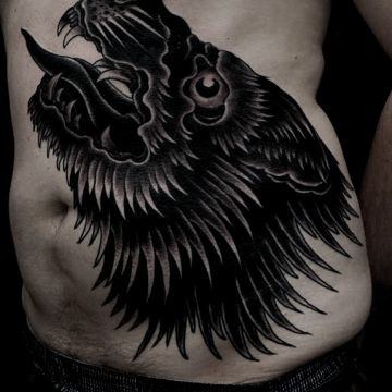 Black Wolf Ribs Tattoo Design