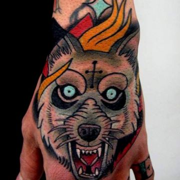 Evil Wolf Cross Hand Tattoo Design