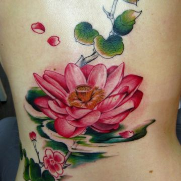 Pink Lotus Flower Ribs Tattoo Design