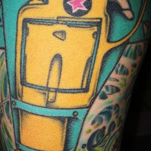 Yellow Gun Star Tattoo Design