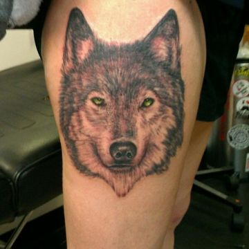 Yellow Wolf Thigh Tattoo Design