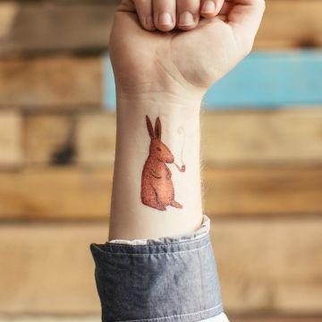 Cartoon Orange Hare Wrist Tattoo Design
