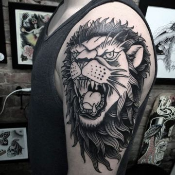 Ink Black Lion Shoulder Tattoo Design