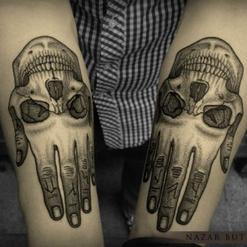 Ink Black Skull Hand Tattoo Design