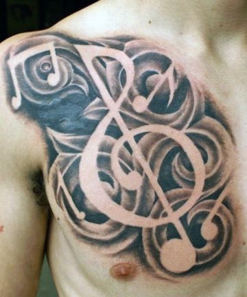 Realistic Black & White Music Chest Tattoo Design