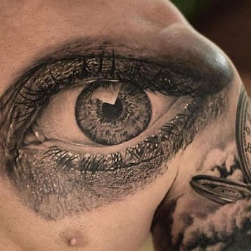 Realistic Black Eye Chest Tattoo Design
