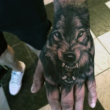 Realistic Black & White Wolf Hand, Head Tattoo Design