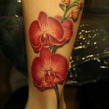 Realistic Red Leg Tattoo Design